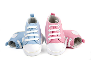baby shoes -pink and blue isolated on white background