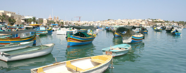 Colorful fishing boats in the harbor of Marsaxlokk, Malta
