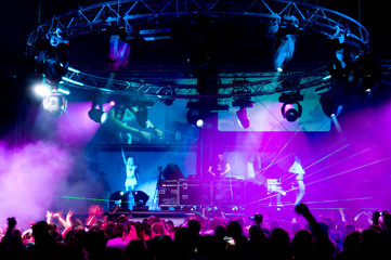 People dancing at the concert, laser show and music
