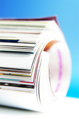 closeup of rolled up magazine pages