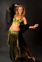 beautiful long hair blonde woman in arabic dance costume