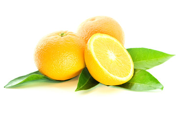 two oranges and half with leaves over white