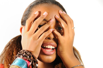 African teen girl with hands on the face - isolated