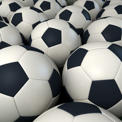 Lots of soccer balls together forming a background
