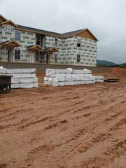 apartment building under construction with earthwork