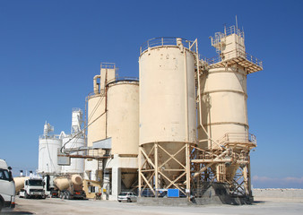 Cement industry with silos and trucks