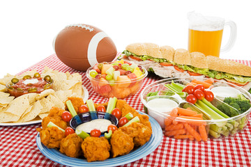Table spread with appetizer trays for the footbal party.