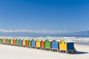 Brightly colored dressing huts on Muizenberg beach.