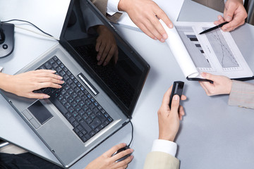 Close-up of businesspeople hands over workplace