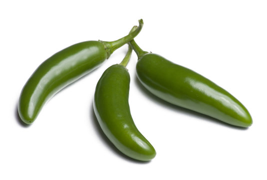 Three serrano peppers isolated on white background