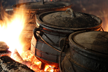 hot cauldron on a fire