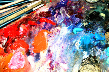 Multi-coloured paints and brush