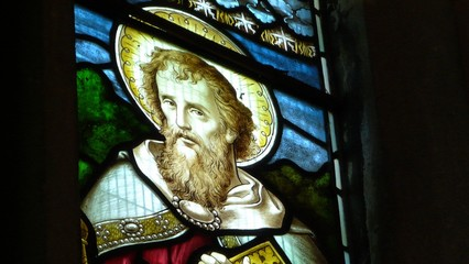 Stained glass window of saint