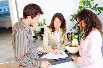 Casual business team working together at office reception,