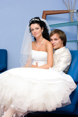 portrait of young couple in wedding wear indoors