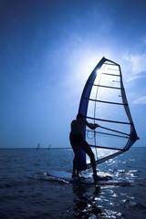 Surfer on sunset on waves