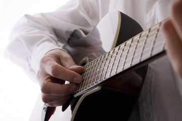 High key acoustic guitar player with copy space
