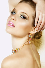 Beautiful blond woman with long lashes and colourful stones