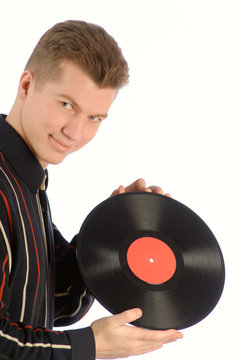 young guy holds in hands vinyl record