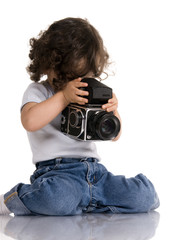 child with old SLR camera
