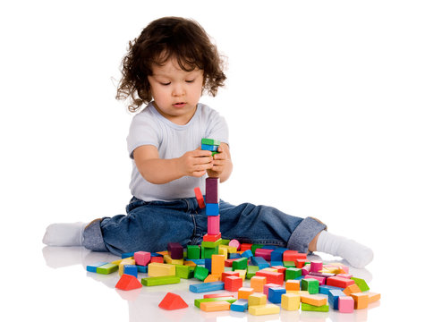 little boy playing with bricks
