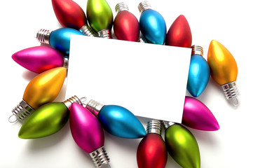 A blank notecard surronded by Christmas decoration or baubles