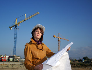 Young architect  in construction site against blue sky