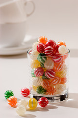food serias: cup with striped sugar candy