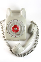 Old analog antique grey telephone with dial wheel, non digital