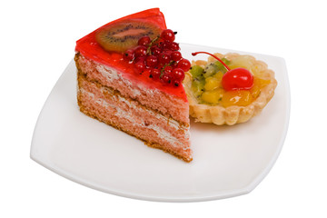 Sweet cakes with fruit on a white background