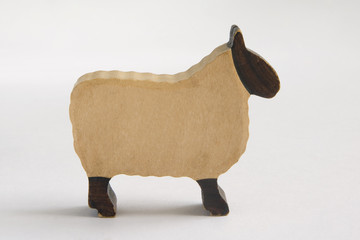 Carved wooden toy sheep from farmyard set