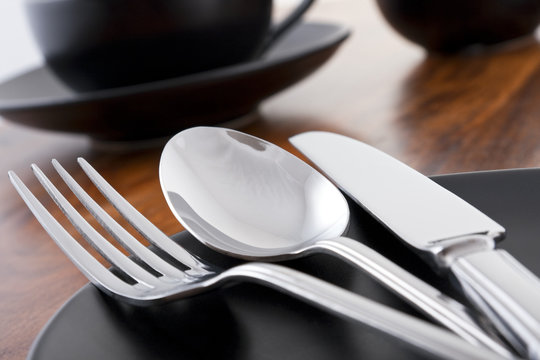 Knife, fork and spoon table setting in cafe