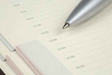 Checklist in an agenda with a silver ballpen