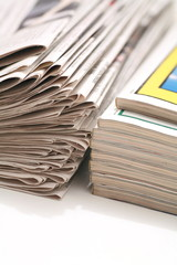 close-up of newspapers/magazine on a white backgroung.