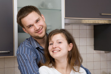 happy couple together in kitchen