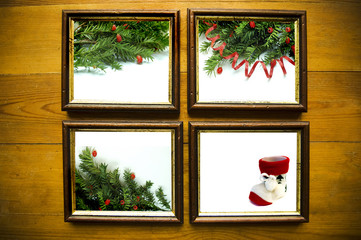 christmas frames on wooden wall