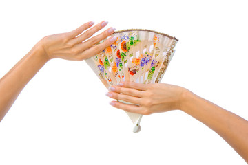 Beautiful fan in woman hand isolated on white background