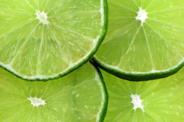 A cut green lime isolated on a white background