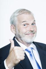 expressive portrait of a handsome senior businessman