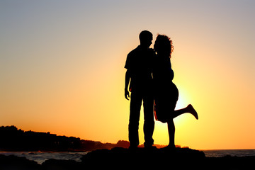 happy couple by the sea silhouette