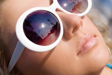 Beautiful girl face in big white sun glasses
