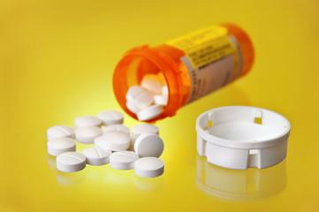 Spilled Prescription Medication w/ Orange Pill Bottle On Yellow