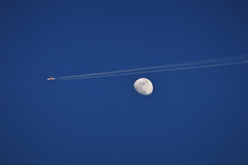 The moon and contrail