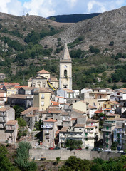 Panorama of the belltower and the village in the valley