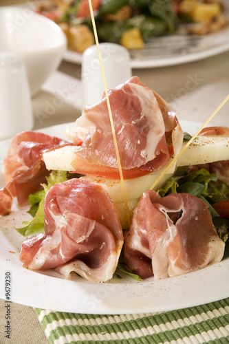 Prosciutto ham with salad decoration canape stock for Prosciutto canape