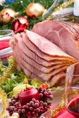Holiday table setting with delicious whole baked sliced ham