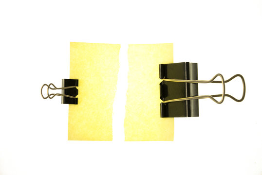 Torn note paper and two clips
