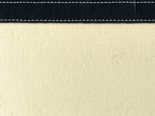 canvas with leather strip and stitching