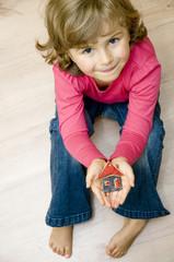 Little house in cute girl hands