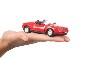 Close-up of red toy car on female's palm